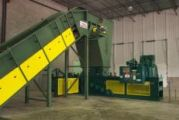 Apron conveyor baler infeed