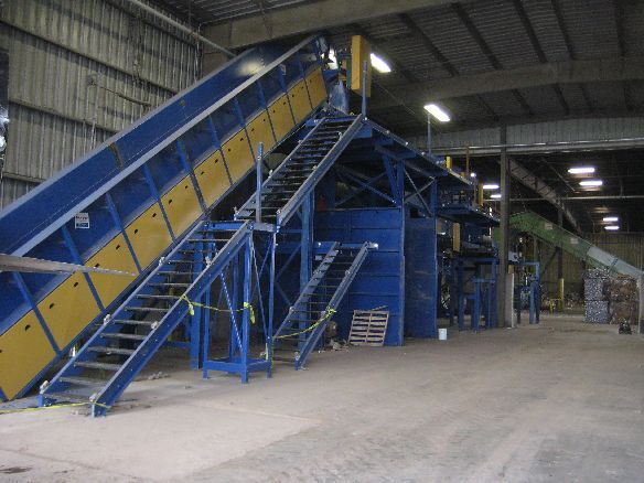 33Infeed apron conveyor with chain curtain for easy metering